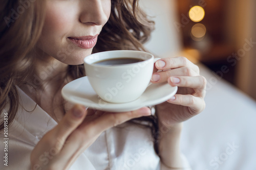 Attractive young girl with a cup