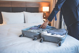 Young businessman with a suitcase - 203919496