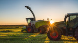 Tractor working agicultural machinery in sunny day - 203920698