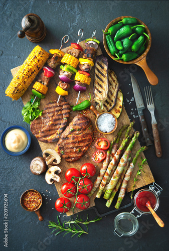 Grilled meat and vegetables on rustic stone plate - 203925604