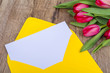 Yellow envelope with tulips on a table