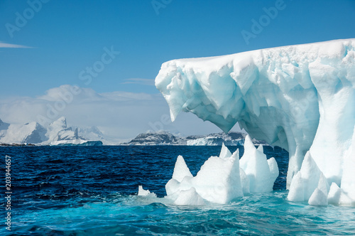 Fotobehang Antarctica Jaws of Ice - Iceberg surrounded by turqouise sea, Antarctica