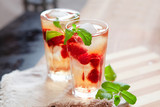 Refreshing summer drink with raspberry, mint and ice copy space