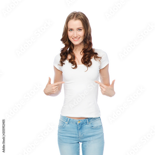 body positive and people concept - happy woman in white t-shirt pointing fingers to herself