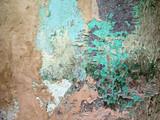 Old colorful and rough wall / Wall with several layers of weathered and scratched paintings. Detail of the facade of a house in Havana, Cuba.