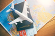 Quadro Plane model with world map, passports and tickets as airplane traveling and tickets booking concept