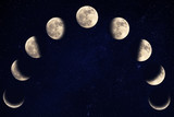 Phases of the moon over blue sky - 203981477