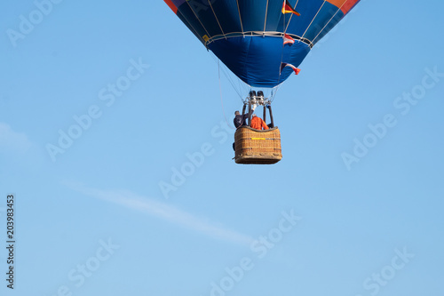 Hot-air balloon in flight nears the ground, It stated to lose altitude as there was a instructing pilot  on board learning soft landings.