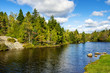 Forest Lake under Blue Sky with Clouds in New Brunswick, Canada.