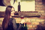 Woman tasting wine in rural cottage interior - 203993097