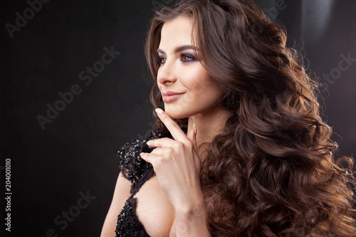 Portrait of a young attractive woman with gorgeous curly hair. Attractive brunette