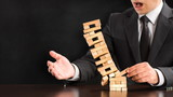 Businessman Fails Building Tower, Concept For Challenge And Fail In Business - 204007807