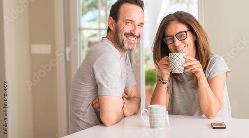 Leinwandbild Motiv Middle aged couple at home