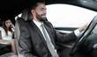 Portrait of a man driving a car - 204055465