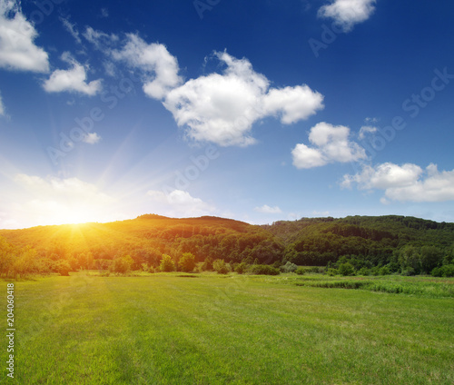 Wall mural Mountain landscape with  sun