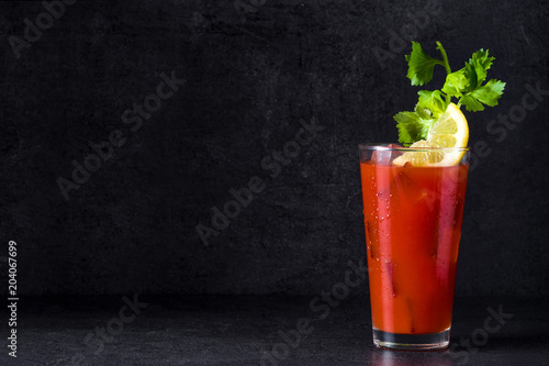Bloody Mary cocktail in glass on black background. Copyspace