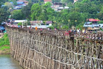 View of the river and surrounding communities of the dam near the Mon Bridge at Khao Laem Dam, Sangklaburi, Thailand. © tharathip