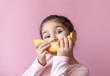 Little girl with yellow banana like smile