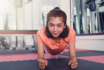Woman doing plank exercise in Gym © palidachan