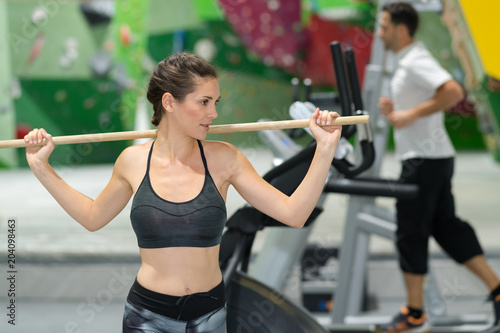 Sticker woman holding a fitness stick