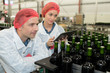 Quadro Workers looking proudly at wine bottles