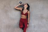Female athlete drinking water - 204118605