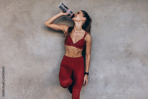 Female athlete drinking water
