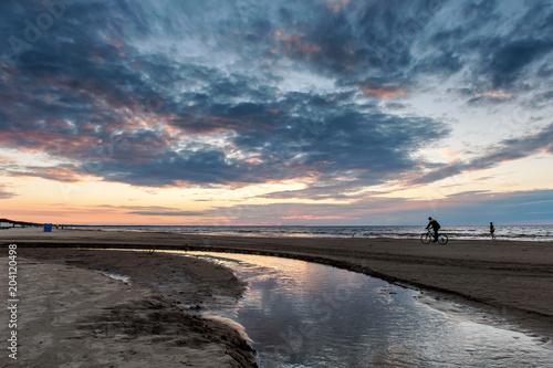 Plexiglas Strand A horizon line, sunset on the beach. Sea, sand, sky. Island concept. Scenic cosmic seascape. After storm