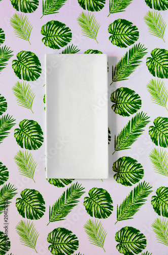 Top view of clean white plate on Palm leaves tablecloth