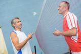 men playing badminton - 204126639