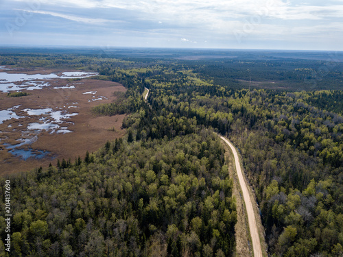 Fotobehang Cappuccino drone image. aerial view of rural area with fields and forests and gravel roads seen from above