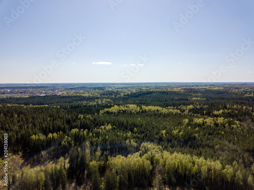 Fotobehang Blauwe hemel drone image. aerial view of rural area with fields and forests