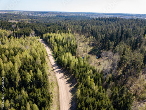Fotobehang Zwart drone image. aerial view of rural area with fields and forests and gravel roads seen from above