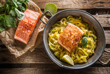 Pieces of roasted salmon with pasta tagliatelle lemon and basil