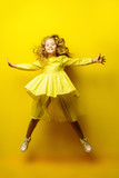 jumping girl in yellow