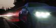 canvas print picture - Scheinwerfer eines Sportwagens in der Nacht