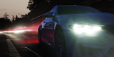 Scheinwerfer eines Sportwagens in der Nacht  - 204157061