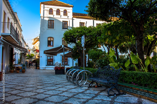 Fototapeta Street. Sunny evening in Estepona street. Malaga province, Andalusia, Spain. Picture taken – 4 may 2018.