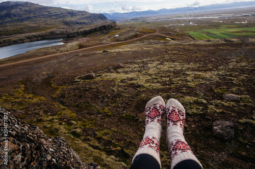 Plexiglas Chocoladebruin Legs in socks with beautiful ornament , on the Iceland nature and moss