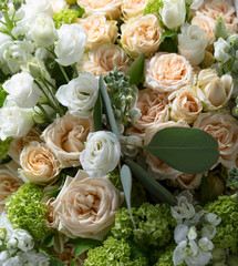 Close up of  bouquet with white and beige roses.