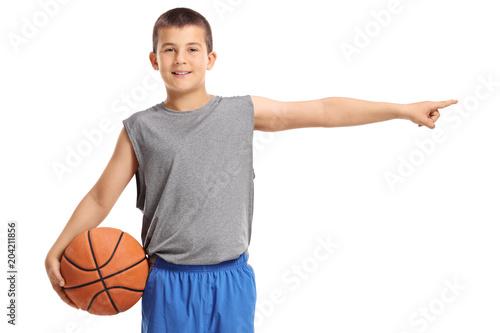 Plexiglas Basketbal Boy holding a basketball and pointing