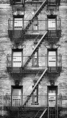 Black and white picture of fire escapes, one of the New York City symbols, USA. - 204220801