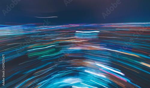 Zamazany abstrakcjonistyczny bokeh tło miasto przy nocą