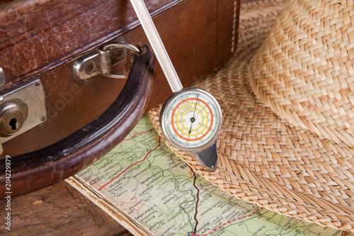 Fototapeta Distance meter and suitcase