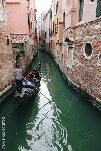 Foto Murales little waterways in venice with gondolier