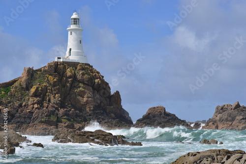 Fotobehang Vuurtoren La Corbiere lighthouse, Jersey, U.K. Telephoto image of a coastal landmark.