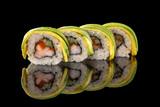 sushi rolls isolated on the black background © mateusz