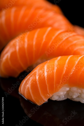 Fotobehang Sushi bar salmon nigiri sushi on the black background
