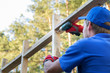 construction worker working on wooden house structure
