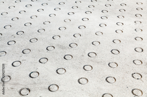 Plexiglas Betonbehang Concrete flooring with round relief pattern